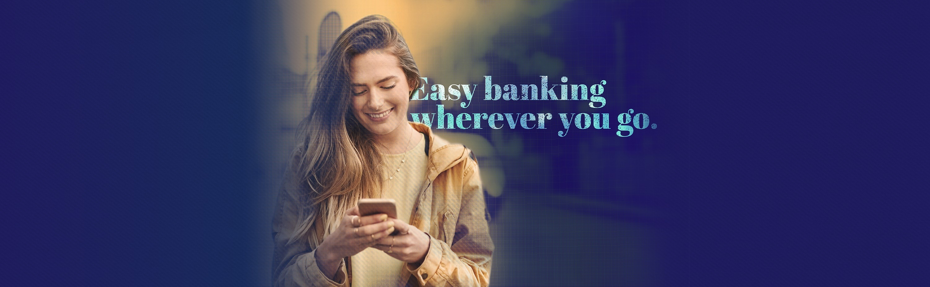 young girl walking and checking her mobile banking app from Fidelity Bank & Trust while smiling. Text on photo says easy mobile banking wherever you go