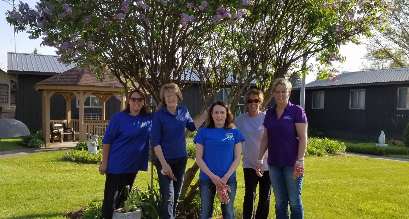 Dyersville planting flowers at nursing home with Fidelity Bank & Trust team