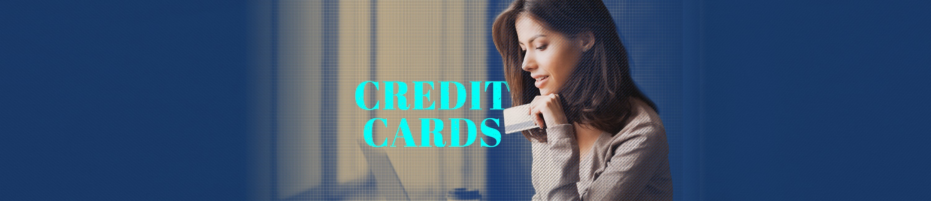 young woman working on a computer while holding her Fidelity Bank & Trust VISA credit card. words on photo say Credit Cards